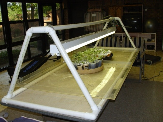 a quick easy grow light frame built of pvc pipe fittings